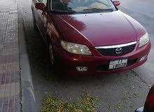 Mazda 323 made in 2000 for sale