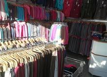 محل للبيع مع كافة مسلتزماته ملابس نسائية و أطفال