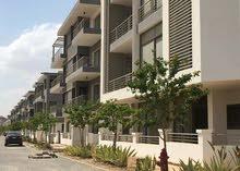 شقة 128م بحديقة بالتقسيط  علي 10 سنوات #تاج سيتي