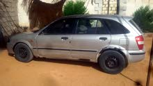 Mazda 323 made in 2001 for sale