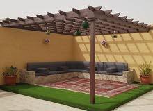 تركيب مظلات حديثه مع عشب طبيعي وصناعي