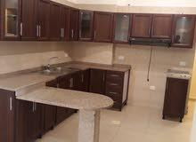 شقة فارغة للايجار بالقرب من دوار الشوابكة في منطقة مرج الحمام مكونة من 2 نوم وصالة ومطبخ امريكي