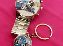 ساعة  ومدالية بداخلها صورة أو عبارة من اختيارك