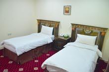 غرفة وحمام / وغرفة وصالة مفرشة بفندق باسعار مناسبة