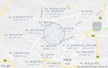 أربد غرب دوار فوعراء بخمسين متر علي الشارع الرئيسي تجاري فخم بنايتين بقوشان واحد