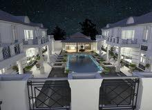 عرض لقطه ارض مخصص قصر رائع او مجمع سكني من 10فلل ومسبح £