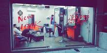صالون حلاقه بالزرقاء الجديدة شارع الوينك بجانب صيدلية كارمن