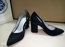 2 pairs of black suede high heels