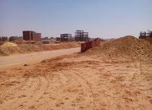 ارض للبيع بمنطقة الاسكان المميز بجوار العاصمة السياحية الجديدة 6 اكتوبر
