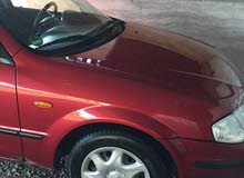 Mazda 323 2000 For sale - Maroon color