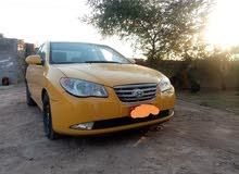 سيارة النترا لون اصفر موديل 2009 للبيع