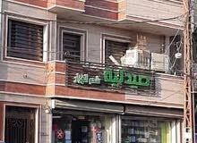 يوجد لدينا بنايه تجاريه للبيع في المنصور حي المتنبي شارع نافع داود  مساحه 120م و