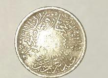 عملة قرش واحد من عام 1344 من عهد الملك عبد العزيز رحمه الله.