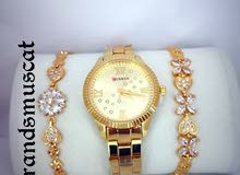 Ladies watch and bracelets