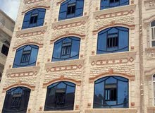 عمارة استثمارية اربع لبن ونصف حر شارع 14 مزفلت تسع شقق وفتحتين وقرش