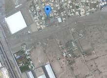أرض للبيع أو للبدل بما يناسب فالرميس خلف الصيني مول وانته متجه صوب صحار