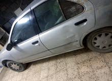 Used condition Nissan Sunny 1998 with +200,000 km mileage