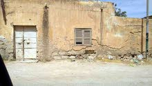 منزل بنى قديم في شارع الوسطى الخياطين غريان تغليسة على الطريق مقطرن مباشرة