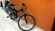للبيع دراجه لونها اسود ماركه x-action القابل للطي ياباني الصنع