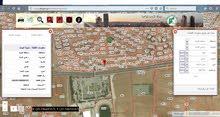 ارض للبيع مقابل كلية الكرك في زحوم