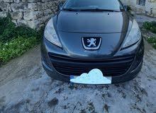 Peugeot 207 sw لون زيتي سقف بانوراميك فيتاس عادي ستايشن حالة جيدةجدا