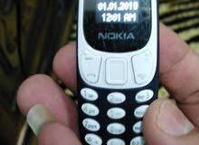 أصغر موبايل بحجم المفتاح