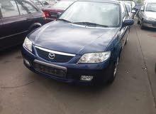 للبيع مازدا 323 شنطة 2004 الوجه الاخير مكيفة سيارة توب الزاوية/طرابلس 0923830705 / 0913228680