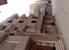 ارض للبيع بميت غمر على ناصيه شارع المدينه المنورة والخزان