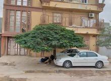 منزل من ثلاث طوابق به 4 شقق في حي الفاتح مقابل باب نادي الهدف