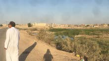 قطعه ارض بالهارثه قرب مدرسه الشهامه