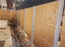 تصنيع وتركيب السور الخارجي من الحديد والخشب وهذه عملي في إكسبو 2020
