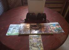 Xbox 360 + 2 manette+6 jeux