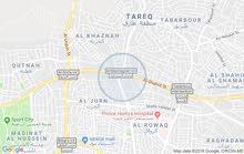 أرض تجاري معارض على دوار المشاغل-طبربور بجانب سامح مول و دائرة الأحوال