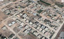 ارض للبيع طريق المطار خلف خزانات النفط