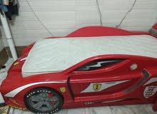 سرير على شكل سيارة فيراري بسعر مغرٍ