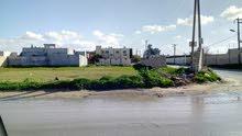 أرض2000 متر تجارية سكنية عين زارة طريق الابيار بعد شيل الرقبة