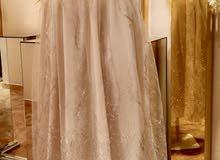 فستان كريمي مستعمل للبيع