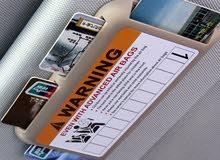 منظم لبطاقات يركب في شمسيه السياره لون بيج