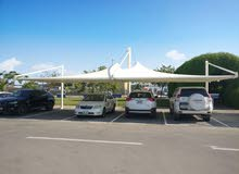 Parking shades and Tensile fabric shades installations all over UAE OMAN KSA