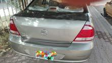 نيسان سني رقم واسط موديل 2012 سيارة مكفولة عدا البارد الموضح بالصور