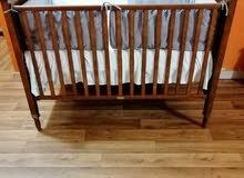 سرير اطفال جونيورز بنى