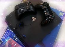 Playstation 4 Pro with 2 controllers and 2 CD Games
