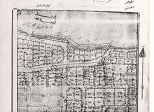 ارض للبيع مقابل مدرسة دار العلوم خلف اربد مول - اربد
