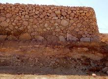بناء سلاسل حجريه إصلاح الأراضي وتشييك 0775061442
