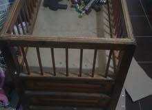 سرير اطفال خشبي