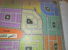 قطعة أرض بالتجمع بيت الوطن الحي الثالث مرحلة ثانية لقطة