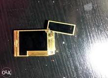 S. T. DuPont vintage gold lighter with vintage leather case