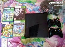 xbox 360 with 4 games and 2 controllers for sale