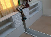 2 wooden beds with drawers