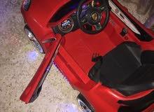 سيارة أطفال لون أحمر تصلح من عمر سنتين لعمر خمس سنوات